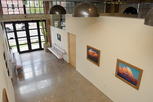 Works from David Holland's Cloudscapes hang in FG Gallery, part of the Fulmer Sill law firm. (Garett Fisbeck)