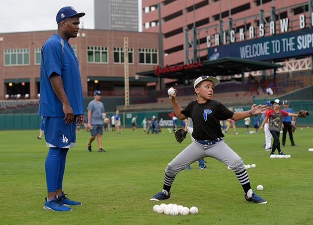 Fabio Castillo works with William Frazier during a recent OKC Dodgers Clinic in conjunction with Supermercados Morelos. - GARETT FISBECK