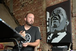 Local artist Jack Fowler, seen here in his Film Row studio, curated the Outnumbered exhibition to rebel against Oklahoma's conservative majority. (Garett Fisbeck)