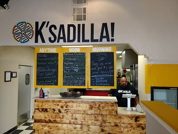 OK'sadilla! owner Charles Griffis works the register.   Photo Greg Elwell
