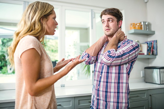 Upset couple having an argument in the kitchen - BIGSTOCK