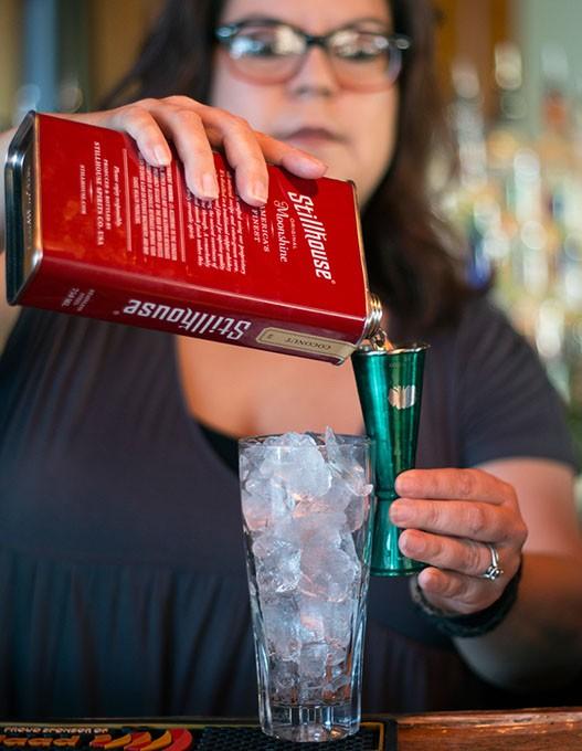 Apothecary 39 bartender Molly Musgrove mixes a Kentucky Colada for a customer on Sunday, June 11, 2017. (Cara Johnson).