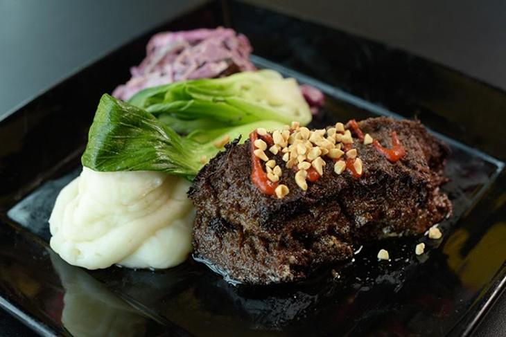 Braised beef cheek with Sriracha caramel sauce, wasabi whipped potatoes and bok choy (Garett Fisbeck)