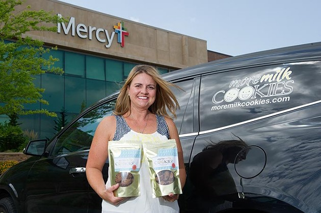 Melany Boughman, of More Milk Cookies, poses for a photo in front of Mercy hospital, one of the locations where her product is sole, in Edmond, Tuesday, July 12, 2016. - GARETT FISBECK