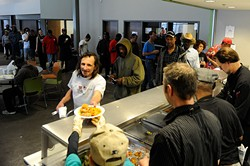 WestTown resource center and day shelter diners queue for a chef-prepared meal during a 2015 Turning the Tables on Hunger event. (Garett Fisbeck / file)