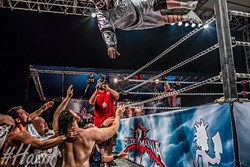 """Insane Clown Posse's Violent J launches over a wrestling ring at a past Gathering of the Juggalos. The Gathering features many sideshows, including wrestling events. (Dustin """"Hazin"""" Lane / Cherry Bomb / provided)"""