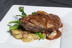 NY Strip in whiskey mushroom demiglace at The Mantel Wine Bar and Bistro Tuesday, June 27, 2017. - GARETT FISBECK