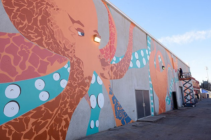 Jack Fowler works on his mural in Bricktown, Thursday, Dec. 1, 2016. - GARETT FISBECK