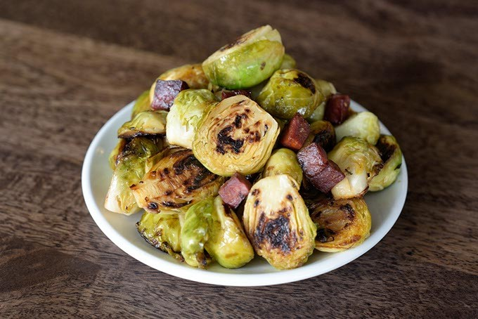 Brussels sprouts with Spanish chorizo at The Pritchard, Wednesday, March 22, 2017. - GARETT FISBECK