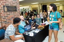 The University of Central Oklahoma's Interfaith Faith returns to campus from 11 a.m. to 2 p.m. Aug. 25. Pictured, representatives from Edmond's Spring Creek Assembly of God speak to a student during 2015 fair. Photo by UCO Photo Services/KT King - UCO PHOTO SERVICES/KT KING