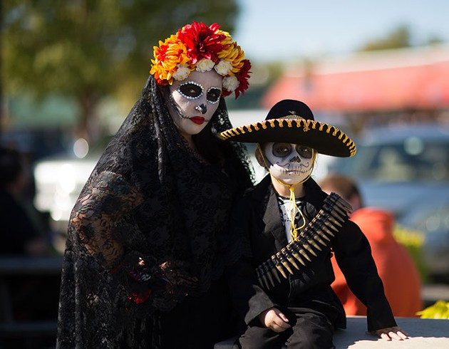 """OKLAHOMA CITY, OK - NOVEMBER 1: During the Dia de los Muertos (Day of the Dead) celebration, November 1, 2015 in Oklahoma City, Oklahoma. Officials were trying to break a world record for people dressed as """"La Calavera Catrinas"""" and """"Catrins"""".  The world record for the most in one place is 509 by Mexico City.(Photo by J Pat Carter) *** Local Caption *** ; - J PAT CARTER) *** LOCAL CAPTION *** ;"""