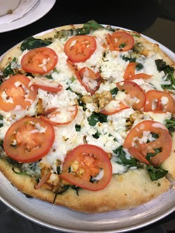 Sergio's pizza crust is made in-house and baked on a pizza stone. | Photo Jacob Threadgill