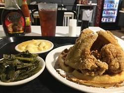 The chicken and waffle, featuring four huge wings, is the signature dish at Mama E's. | Photo Jacob Threadgill