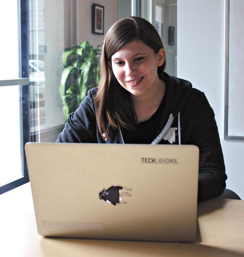 Amanda Harlin, a co-founder of Techlahoma, works in the coworking space of StarSpace46 west of downtown Oklahoma City. (Photo Laura Eastes)