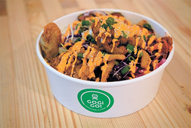 A combination bowl features grilled chicken, bulgogi beef, spicy pork, rice, japchae and toppings.   Photo Jacob Threadgill