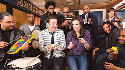 """The Roots perform """"Let It Go"""" using only classroom instruments with (center) Jimmy Fallon and Idina Menzel on The Tonight Show Starring Jimmy Fallon. (Photo YouTube / provided)"""