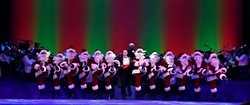 The kick line of tap-dancing Santas remains one of the highlights of OKC Phil's The Christmas Show.   Photo Oklahoma City Philharmonic / provided
