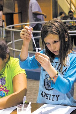 A child participates in a DNA extraction activity during a CSI Science Overnight at Science Museum Oklahoma. | Photo Science Museum Oklahoma / provided