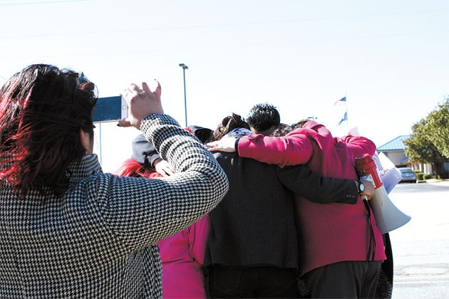 Members of Dream Act Oklahoma engage in a group hug with a Norman family two days after their father was detained by immigration officers in late October. | Photo Laura Eastes