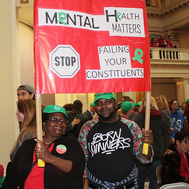 Sharon Smith and Marlon Smith protest proposed cuts to the Oklahoma Department of Mental Health and Substance Abuse Services at the Oklahoma Capitol last week. (Photo Laura Eastes)