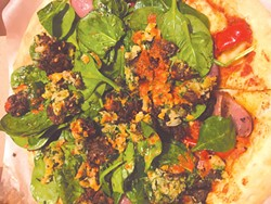 The Brogan Vegan pizza is baked and then topped with spinach, falafel and a red pepper sauce. (Photo Jacob Threadgill)