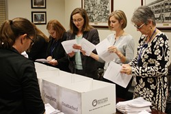 Frances Kersey, city clerk of Oklahoma City (far left) is joined by other city employees reviewing the initiative petitions competed by Save OKC Schools coalition. (Photo Laura Eastes)