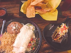 The chicken enchilada plate comes with a hard-shell taco. | Photo Jacob Threadgill