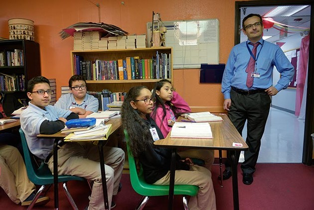 Superintendent Umit Alpasian observes a seventh-grade English class at Dove Science Academy, which was one of six Oklahoma schools named a National Blue Ribbon School in 2017. (Photo Garett Fisbeck)