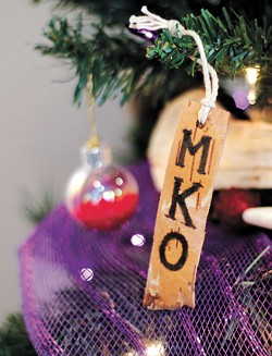 "Representatives of the Citizen Potawatomi Nation decorated their tree with a birch bark tag featuring ""MKO,"" which translates to ""Bear."" 