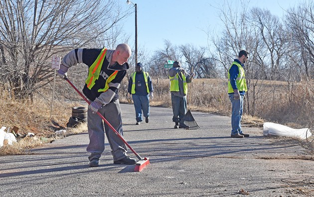 Participants in the Center for Employment Opportunities remove debris from an illegal dumpsite in northeast Oklahoma City. (Photo Laura Eastes)