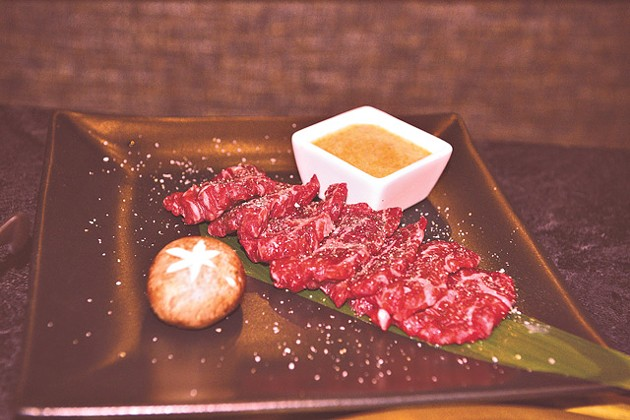The prime filet is infused with applewood smoke that pours out when brought to the table. (Jacob Theadgill)