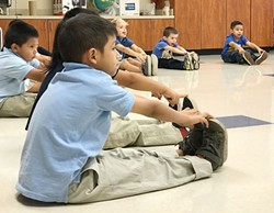 A Pierce Elementary School student stretches as part of a class taught by Oklahoma City Ballet.(Photo provided)