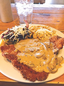 A new entree version of pork schnitzel is topped with mushroom gravy and joined by spaetzle and Brussels sprouts. | Photo Jacob Threadgill
