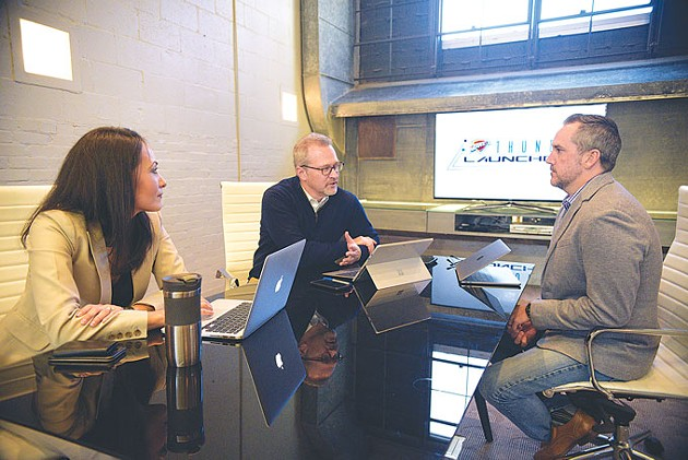 from left Erika Lucas, Brian Byrnes and Chris Lucas discuss Midtown's Thunder Launchpad, which will house a business accelerator program operated by StitchCrew. | Photo Laura Eastes