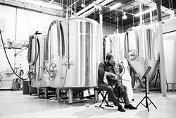 Cellist Steuart Pincombe performs during Anthem Brewing Company's live music series. Shows can typically be seen Fridays and Saturdays at the brewery's taproom. | Photo Nigel Bland Company / provided
