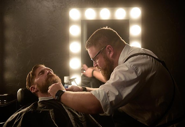 Joel Robinson trims Ben Grunewald's beard at the newly opened Manscape & Massage Clinic. (Garett Fisbeck)