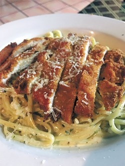 A lunch portion of linguine with pesto cream topped with a fried chicken cutlet | Photo Jacob Threadgill