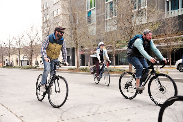 Cyclists travel in downtown Oklahoma City to visit proposed bicycle infrastructure in bikewalkokc's draft plan last week.   Photo Laura Eastes