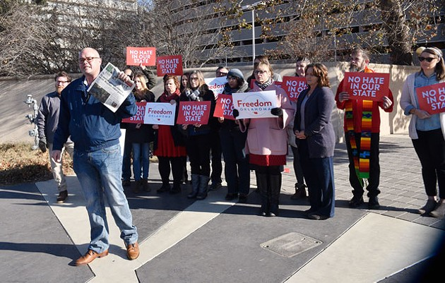Troy Stevenson and John Rex Charter Elementary School parents protest former Oklahoma City Mayor Kirk Humphreys' position on the elementary school board days after Humphreys discussed homosexuality on local television. (Photo Laura Eastes )