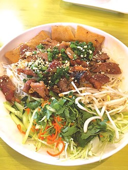The vermicelli bowl includes house-made egg rolls and grilled pork. (Photo Jacob Threadgill)