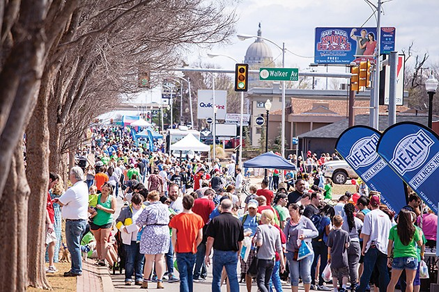 People flood the streets for Open Streets OKC in the Uptown 23rd District. The health and wellness event returns April 8. - OCCH / PROVIDED