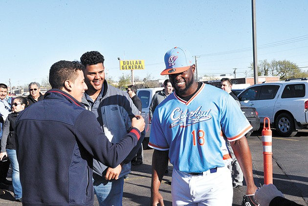 Oklahoma City Dodgers fans interact with college baseball player Juan Fuentes wearing the new Cielo Azul jersey. - LAURA EASTES