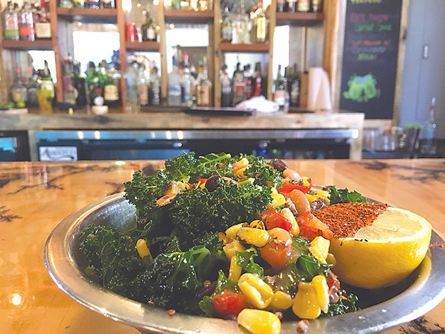 A massaged kale salad with corn, black and pinto beans, red bell peppers, lemon, quinoa and house dressing. - JACOB THREADGILL