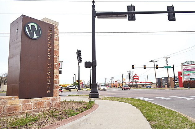 "A streetscape revitalization project brought markers to The Windsor District, including this 11-foot-tall ""W"" backlit with an LED beam that now stands at NW 23rd Street and Meridian Avenue. - LAURA EASTES"