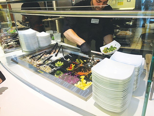Guests choose which vegetables and protein - to pair with either rice or noodles at the Asian bowl station in Nebu. - JACOB THREADGILL