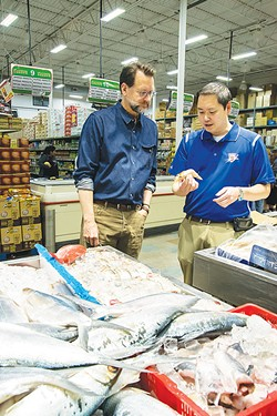 Ba Luong tells chef Kurt Fleischfresser about the latest shipment of tiger prawns. - MARK HANCOCK