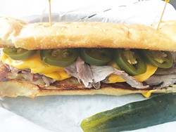 The APC is roast beef, caramelized onions, jalapeños and American cheese on garlic bread. - JACOB THREADGILL