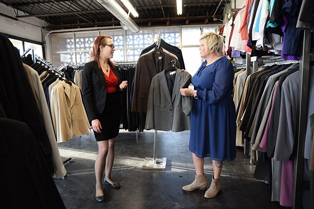 from left Dress for Success' boutique manager Lea Gallagher assists client Dusty Summers with new wardrobe choices. Summers has become a property manager after graduating from Dress for Success. - MARK HANCOCK