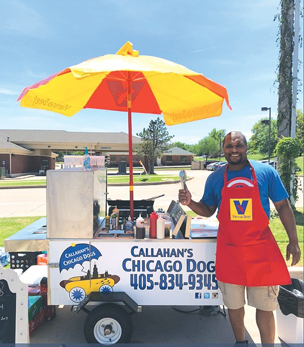 Dewayne Callahan stands near his hot dog truck in a photo that garnered over 115,000 retweets on Twitter. - PROVIDED
