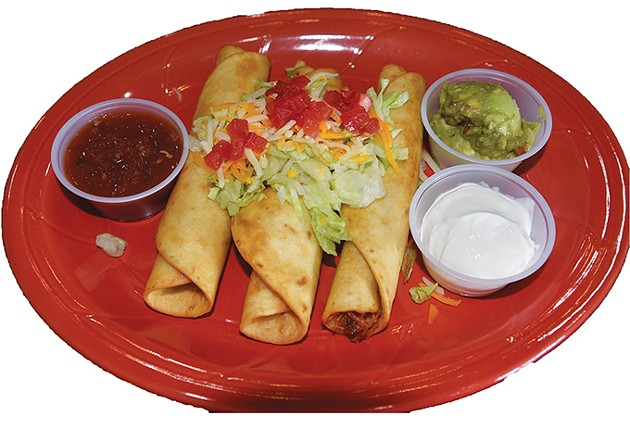 The rolled tacos are lightly fried to keep the interior of the flour tortillas soft. - JACOB THREADGILL